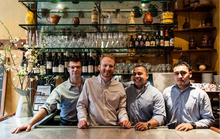 A Welcoming photograph of the staff at Le Gigot.